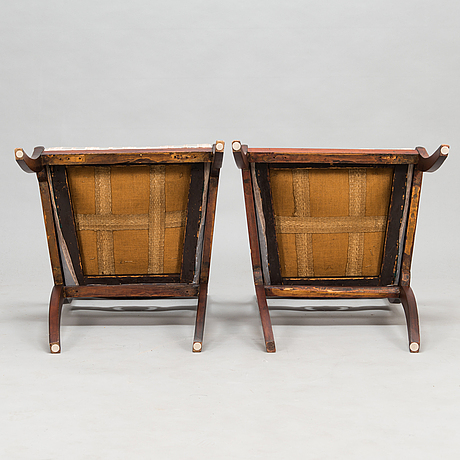 Two open armchairs from latter half of the 19th century.