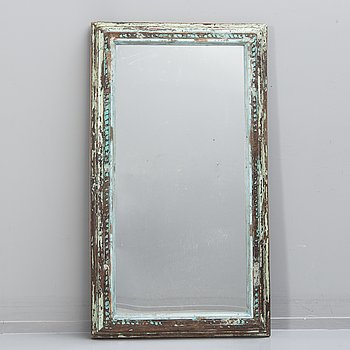 An Indian panted wood mirror 20th/21st century.