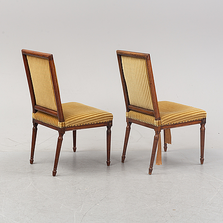 Seven louis xvi-style chairs from around the year 1900.