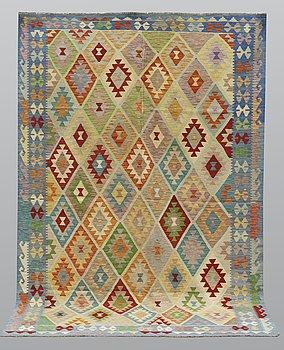 A carpet, kilim, ca 305 x 208 cm.