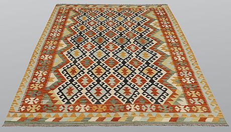 A rug, kilim, ca 250 x 182 cm.