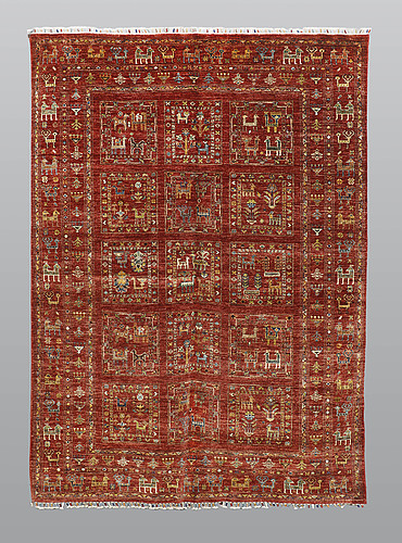 A rug, ziegler design figural, ca 235 x 168 cm.