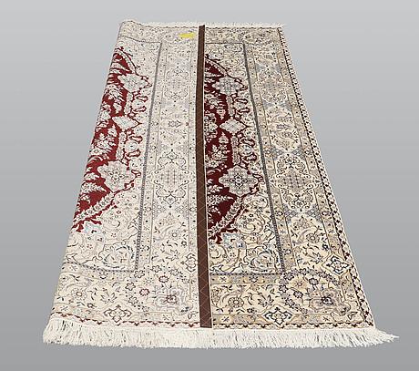 A carpet, nain part silk s.k 6laa, 239 x 155 cm.