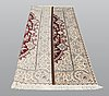 A carpet, nain part silk s.k 6laa, 239 x 155 cm.