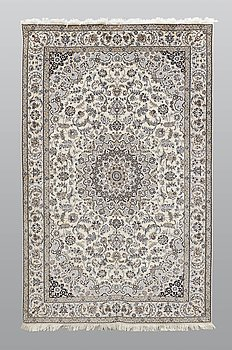 A carpet, Nain part silk so called 6 LAA, signed, ca 240 x 137 cm.