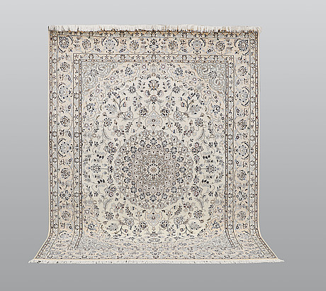 A carpet, nain part silk s.k 9laa, ca 260 x 200 cm.