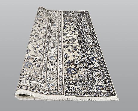 A rug, nain part silk, ca 240 x 164 cm.