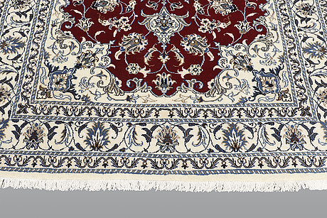 A rug, nain part silk, ca 208 x 149 cm.