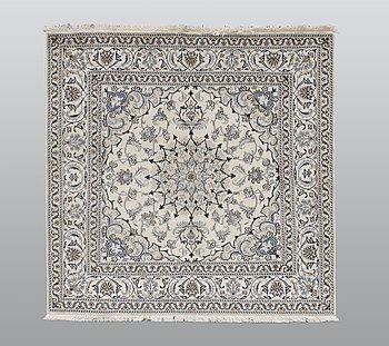 A rug, Nain part silk, ca 202 x 197 cm.