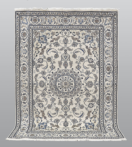 A carpet, nain part silk, ca 290 x 198 cm.