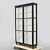 A 20th century painted display cabinet.