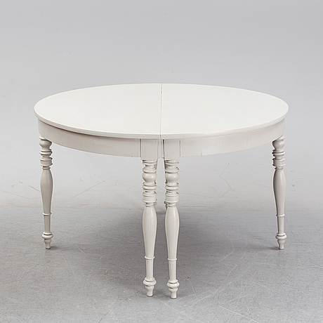 A painted dining table, late 19th century.