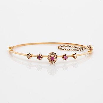 Rose-cut diamond and pink sapphire bangle.