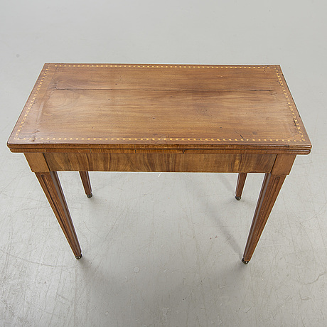 A mahogany empire game table first half of the 19th century.