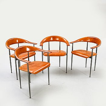 A set of four Fasem armchairs later part of the 20th century.