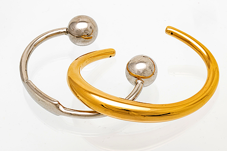 2 bangles, metal, marc jacobs and calvin klein.