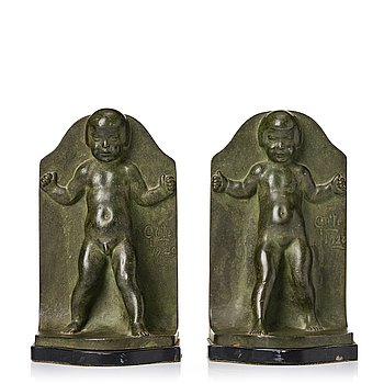 279. Axel Gute, a pair of green patinated metal bookends, Sweden, dated 1920.