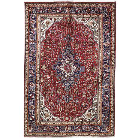 A carpet, tabriz, ca 310 x 208 cm.