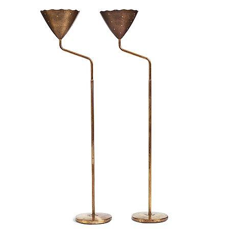 A pair of swedish modern brass uplights, 1940's.