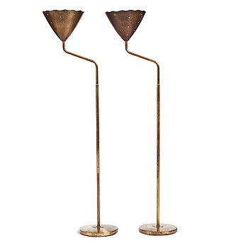349. A pair of Swedish Modern brass uplights, 1940's.