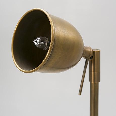 A set of three brass floor lamp 21st century.