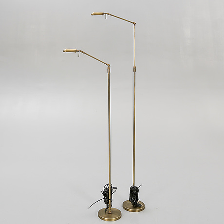A pair of brass floor lamps 21 st century.