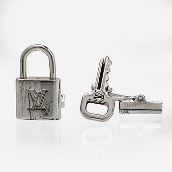 Louis Vuitton,  manschettknappar ett par samt fodral.