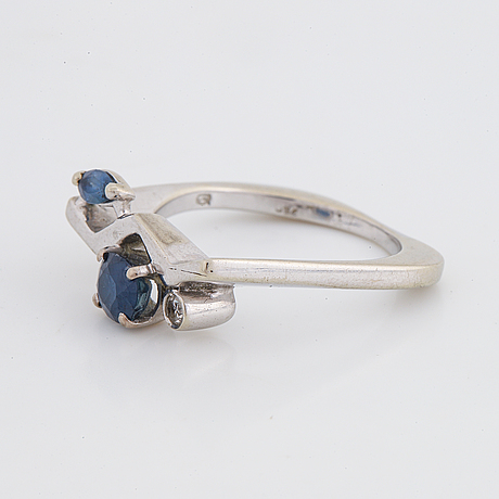 Navette and oval sapphire and diamond ring.