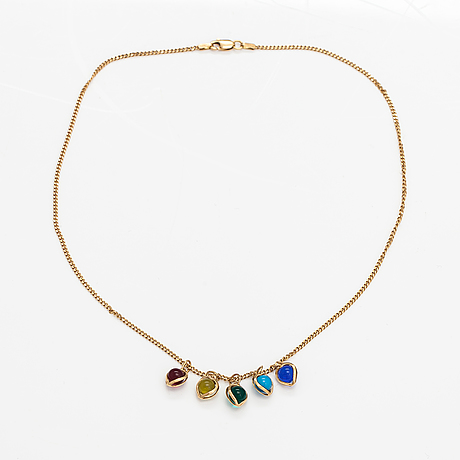 A 14k gold neckalce with glass pearls.