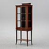 An early 20th century vitrine cabinet.