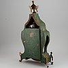 A rokoko style table clock. pendulum and two keys. 19/20th century.