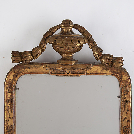 A pair of gilt and bronzed mirror, 18th century.