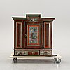 A swedish wall cabinet, dated 1818.