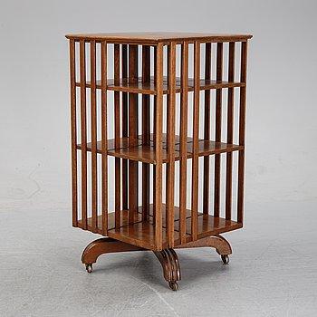 An oak revolving book case, early 20th Century.