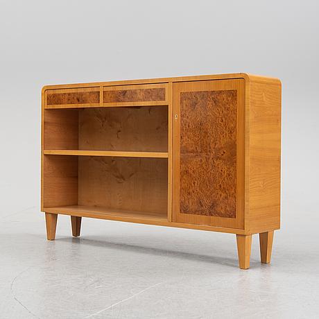 A bookshelf, 1940s.