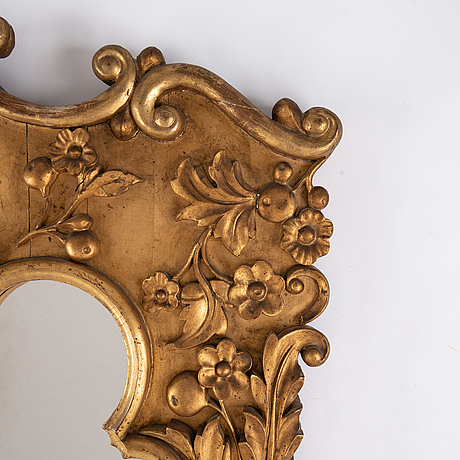 A late 19th century bronzed mirror.