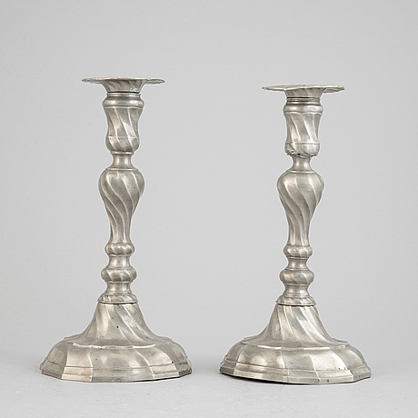 A pair of rococo style pewter candlesticks, 19th century.
