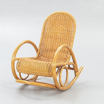 A  bamboo and rattan rocking chair later part of the 20th century.