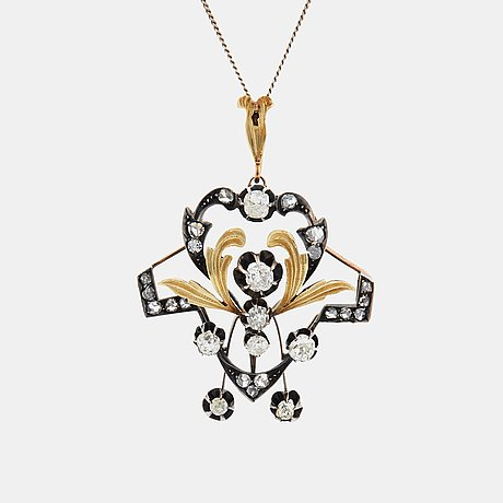 A 14k gold and silver pendant set with old- and rose-cut diamonds.