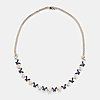 An 18k white gold necklace set with round brilliant-cut diamonds and sapphires.