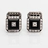 A pair of platinum cufflinks with onyx and old-cut diamonds ca. 2.32 ct in total.