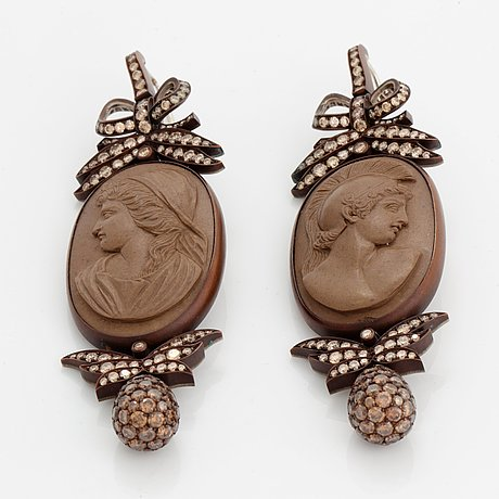 A pair of hemmerle 19th century lava cameo earrings with classical portraits.