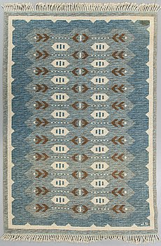 A Swedish flatweave carpet signed JS ca 226 x 166 cm.