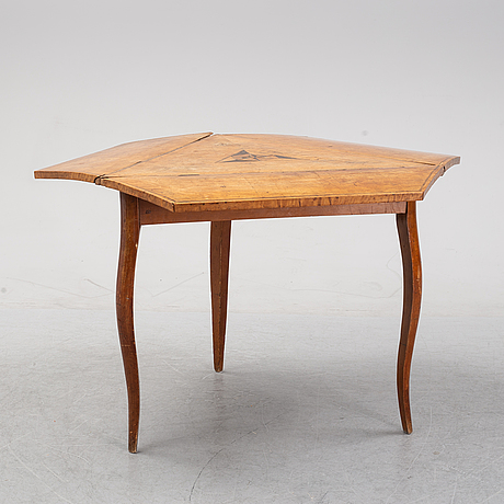 A 19th century drop leaf table.