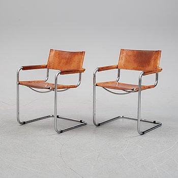A pair of tubular steel chairs from Fasem, Italy.