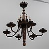An iron and oak chandelier, 20th century.