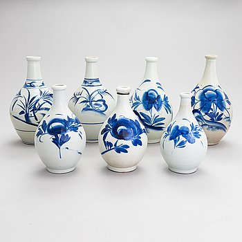 Seven ceramic sake bottles, Japan, the first half of the 20th century.