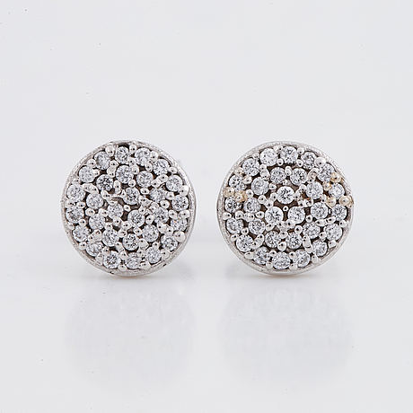 White gold and brilliant-cut diamond earrings.