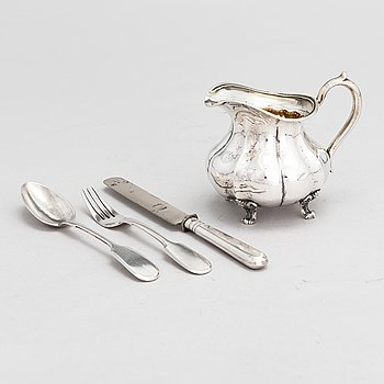 A Russian silver milk jug, and a silver fork, knife and spoon, Saint Petersburg 19th century.