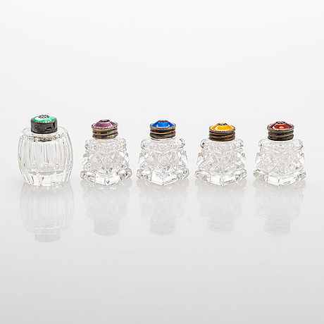 Five shakers with enamel and sterling silver lids, 20th century. one marked denmark, all with swedish control marks.